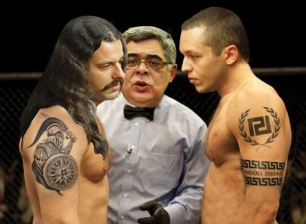 Έτοιμοι να λύσουν τις εσωκομματικές τους διαφορές με το kickboxing τα δύο κορυφαία στελέχη της Χρυσής Αυγής Κωνσταντίνος Μπαρμπαρούσης και Ηλίας Κσσιδιάρης, με διατητή τον Νίκο Μιχαλολιάκο.