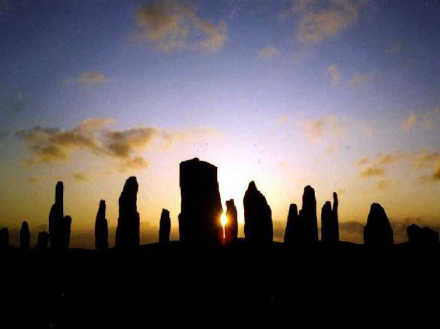 The Callanish Standing Stones at sunset on Midsummer's night.