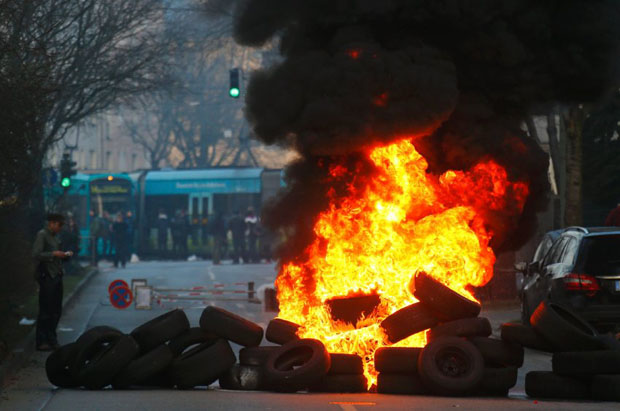 A street blockade of anti-capitalist protesters burns near the new ECB headquarters in downtown Frankfurt